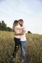 Couple embracing in field - FOLF06218