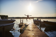 Boy jumping on a pier - FOLF06347