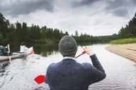 Man rowing on river in north of Sweden - FOLF06407
