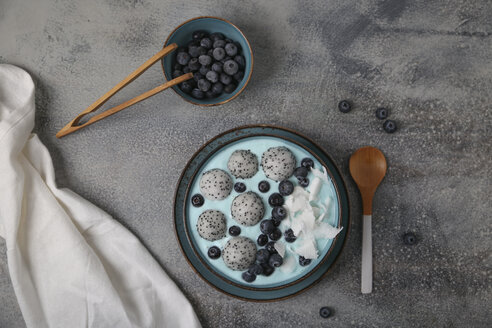 Blue smoothie bowl with grated coconut, blueberries and dragon fruit balls - RTBF01132