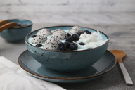 Blue smoothie bowl with grated coconut, blueberries and dragon fruit balls - RTBF01135
