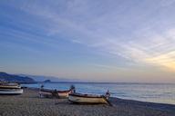 Italy, Liguria, Riviera di Ponente, Noli, fishing boats at beach at sunrise - LBF01874
