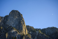 Low angle view rock formation against clear blue sky - CAVF32274