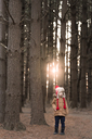 Thoughtful boy standing in forest - CAVF32371