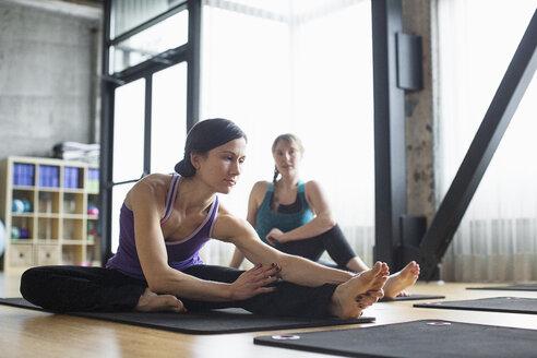 Women exercising on exercise mats in gym - CAVF33154