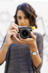 Close-up of woman with camera - VABF01522