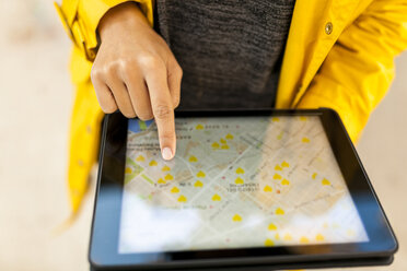 Close-up of woman using tablet with digital street map - VABF01528