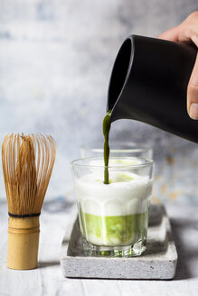 Matcha Latte, pouring matcha tea in a glass - SBDF03503