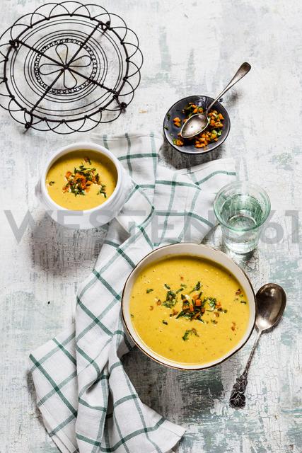 Bowls of vegan creamy carrot soup with coconut milk - SBDF03516