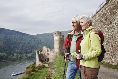Germany, Rheingau, happy senior couple looking at view - RORF01242