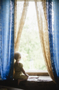 Girl looking through window - FOLF07656