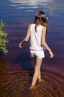 Rear view of girl wading in river - FOLF07695