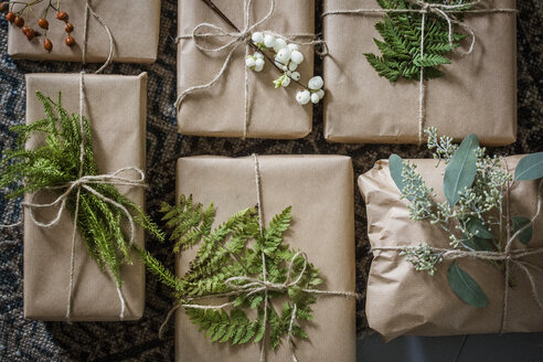 Wrapped Christmas presents with twigs - FOLF07743