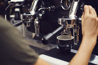 Cropped image of barista making coffee at cafe - CAVF33588
