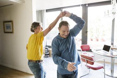 Senior couple dancing at home - CAVF33771