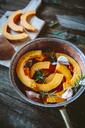 Pumpkin slices, garlic and rosemary  in casserolle - GIOF03898
