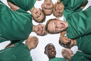 Happy young football players huddling - WESTF24035