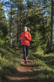 Young woman jogging in forest - FOLF08863