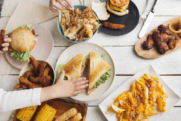 Children's hands on table full of American food - SKCF00391