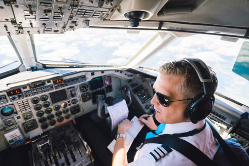 High angle view of pilot sitting in cockpit - MASF00017