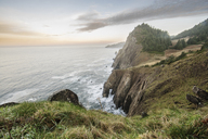 High angle view of cliff by sea against sky - CAVF34663