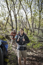Friends hiking in forest - CAVF34855