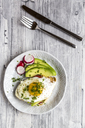 Toast with with fried egg, avocado, red radish, tomato and cress - SARF03656