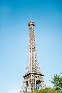 Low angle view of Eiffel Tower against blue sky on sunny day - CAVF35065