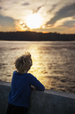 Rear view of boy looking at sunset - CAVF35092