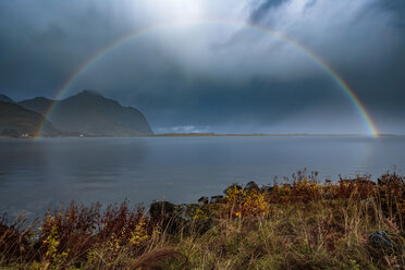 Norway, Lofoten Islands, Bostad, rainbow and dark clouds - WVF00978