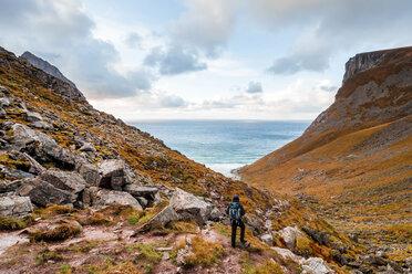 Norway, Lofoten Islands, hiker on the way to Kvalvika Beach - WVF01017