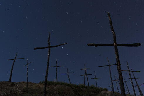 Spain, Manresa, burned forest with symbols of crosses at night - SKC00404