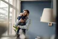 Father spending time with his son at home - KNSF03715