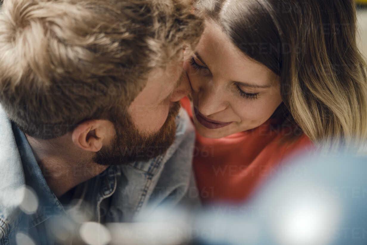 Affectionate couple cuddling at home - KNSF03727 - Kniel Synnatzschke/Westend61