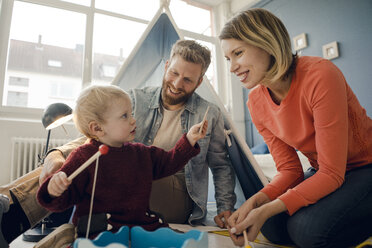 Happy family playing with their son at home - KNSF03751