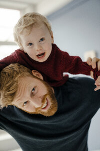 Father and baby son having fun together at home - KNSF03763
