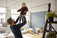Father and baby son having fun together at home - KNSF03778