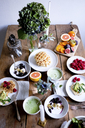 High angle view of various food on wooden table by wall - MASF00828