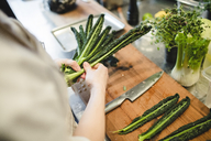 Midsection of female chef preparing vegetable at kitchen - MASF00894
