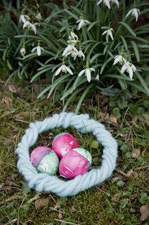 Easter nest made of light blue felt and three dyed Easter eggs - GISF00313