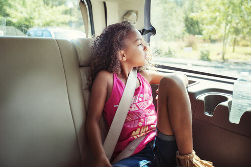 Girl looking away while traveling in car - CAVF35240