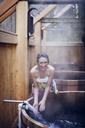 Young smiling woman at sauna - CAVF35336