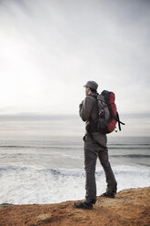 Man standing on edge of cliff - CAVF35357