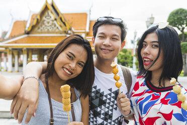 Thailand, Bangkok, portrait of friends with street food taking selfie - WPEF00185