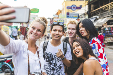 Thailand, Bangkok, Khao San Road, group of friends taking selfie with smartphone - WPEF00206