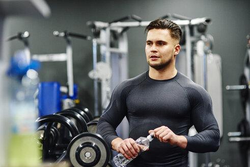 Man taking a break in gym - ABIF00250