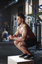 Man doing exercises at gym - ABIF00256