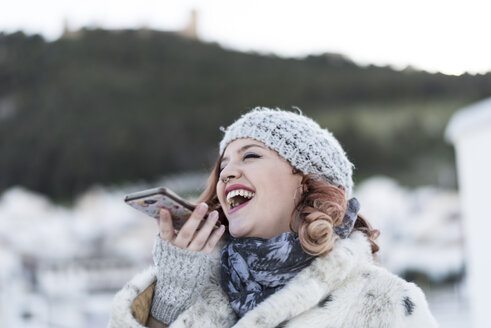 Laughing young woman on the phone - JASF01870