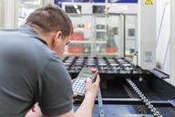 Man operating machine in factory - DIGF03686