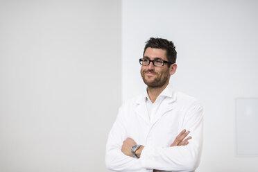 Portrait of smiling man wearing work coat - DIGF03749